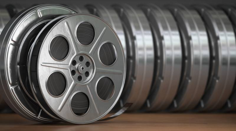 Video, cinema, movie, multimedia concept. A row of vintage film